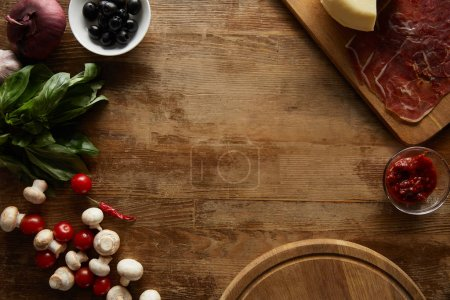 Photo for Top view of raw ingredients on wooden background - Royalty Free Image