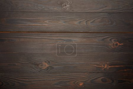 Top view of brown wooden background