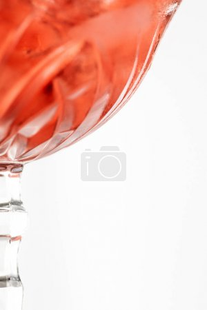 selective focus of wet glass with red cocktail isolated on white