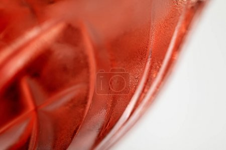 close up of red cocktail in glass isolated on white