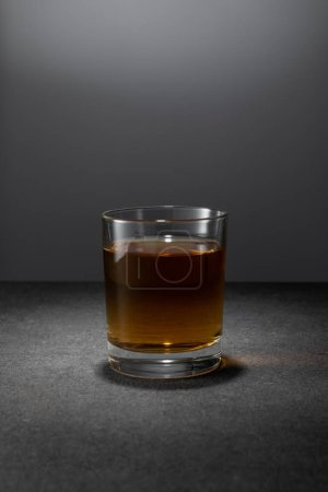 Photo for Alcohol drink in glass on grey background - Royalty Free Image