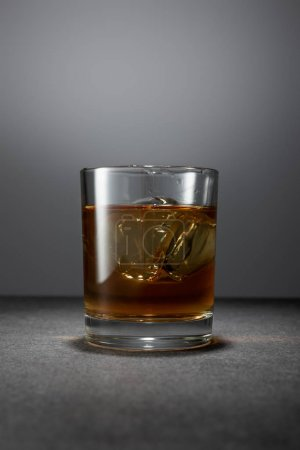 Photo for Ice cubes in alcohol drink on grey background - Royalty Free Image