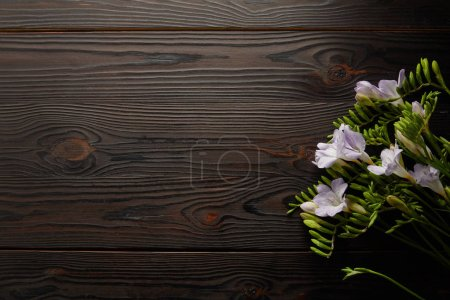 Photo for Top view of violet floral bouquet on wooden table - Royalty Free Image