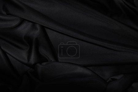 Photo pour Top vue d'arrière-plan textile noir - image libre de droit