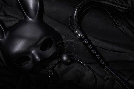 Foto de Top view of sex toys on black textile background - Imagen libre de derechos
