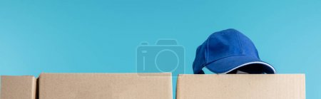 Photo for Cap on cardboard package isolated on blue, panoramic shot - Royalty Free Image