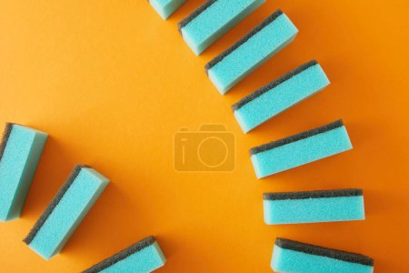 Photo for Top view of blue sponges for house cleaning on orange - Royalty Free Image