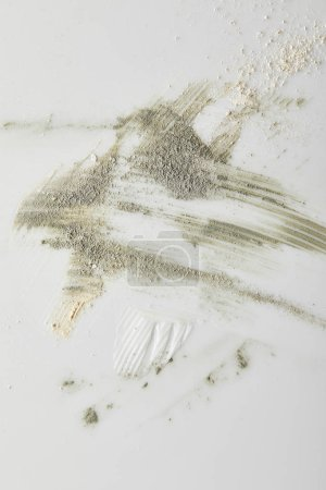 Photo for Top view of clay powder, cosmetic and tone cream brushstrokes on grey - Royalty Free Image