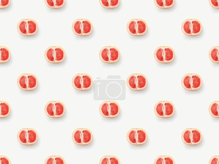 Photo for Top view of grapefruits halves on white background - Royalty Free Image