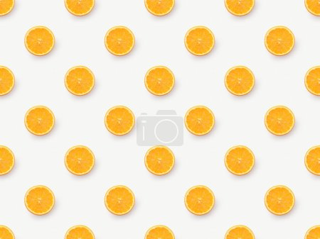 Top view of orange slices on white background