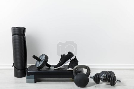 Photo for Black fitness mats and sport equipment at home - Royalty Free Image