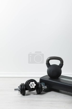 Photo for Step platform, dumbbells and kettlebell at home - Royalty Free Image