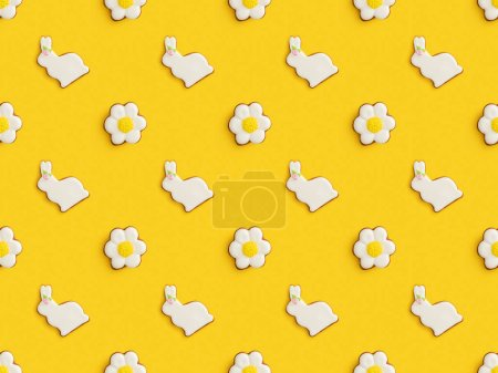 Flat lay with tasty easter cookies isolated on yellow background, seamless pattern
