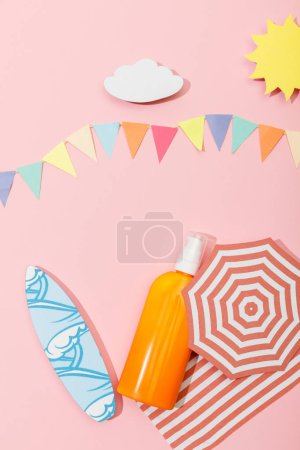 Photo for Top view of paper cut beach with dispenser bottle of sunscreen on pink - Royalty Free Image