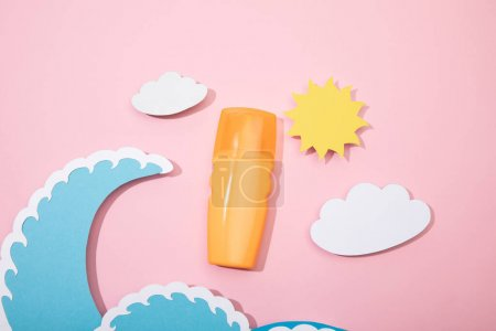 Photo for Top view of paper cut beach with dispenser bottle of sunscreen on pink background - Royalty Free Image