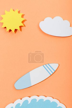Photo for Top view of paper cut sun, cloud, surfboard and sea wave on orange background - Royalty Free Image