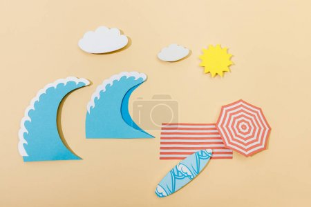 Photo for Top view of paper cut summer beach on beige background - Royalty Free Image