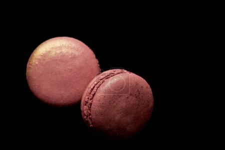 Photo for Top view of shiny pink french macaroons isolated on black - Royalty Free Image