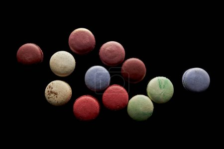 Photo for Top view of assorted delicious colorful french macaroons isolated on black - Royalty Free Image