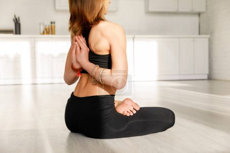 Photo for Cropped view of girl in reverse prayer pose practicing yoga - Royalty Free Image