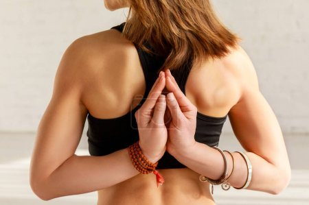 Photo for Cropped view of girl in reverse prayer pose - Royalty Free Image