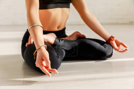 Photo for Cropped view of young woman with barefoot practicing yoga - Royalty Free Image