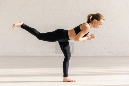 Photo for Side view of woman in warrior with praying hands pose - Royalty Free Image