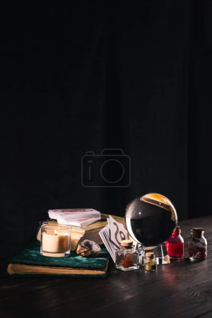 Photo for KYIV, UKRAINE - JANUARY 9, 2020: occult and mystical objects on wooden and black background - Royalty Free Image