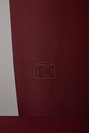 Photo for Burgundy soft textured cloth isolated on grey - Royalty Free Image
