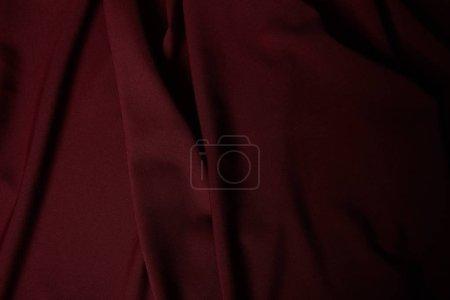 Foto de Paño texturizado suave y arrugado burdeos oscuro - Imagen libre de derechos