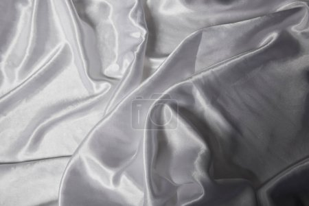 Photo for Close up view of white soft and crumpled silk textured cloth - Royalty Free Image