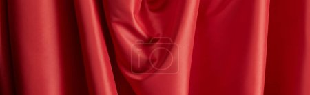 Photo for Close up view of red soft and wavy silk textured cloth, panoramic shot - Royalty Free Image