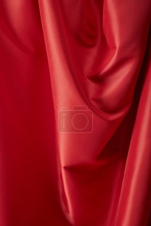 Photo for Close up view of red soft and wavy silk textured cloth - Royalty Free Image