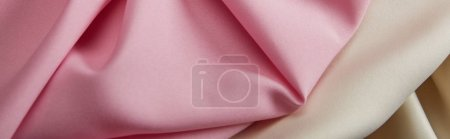 Photo for Close up view of satin pink and white soft and wavy fabric, panoramic shot - Royalty Free Image