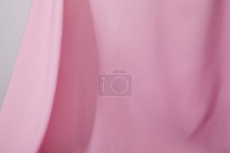 Photo for Close up view of pink soft wavy fabric isolated on grey - Royalty Free Image