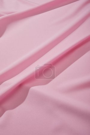 Photo for Close up view of pink soft wavy fabric - Royalty Free Image