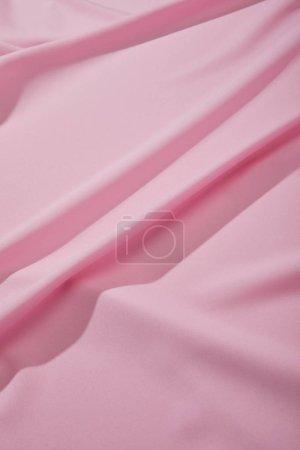 Photo pour Vue rapprochée du tissu ondulé doux rose - image libre de droit