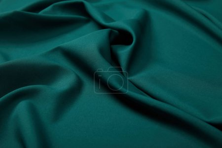 Photo for Close up view of emerald soft and wavy silk fabric - Royalty Free Image