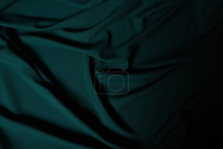 Photo for Close up view of dark emerald soft and wavy silk fabric - Royalty Free Image