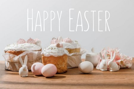 Photo for Decorative bunnies, chicken eggs, sugar bowl, Easter cakes and petals isolated on grey with happy Easter illustration - Royalty Free Image