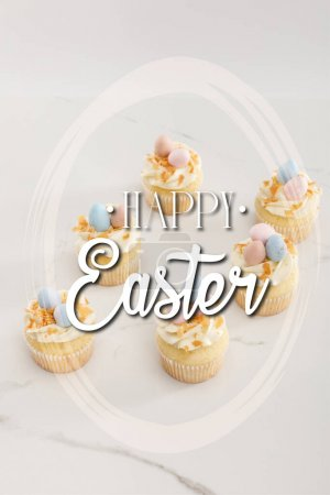 Photo pour Delicious easter cupcakes with painted quail eggs on top on white background with happy Easter illustration - image libre de droit