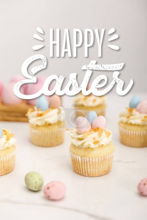Photo for Selective focus of delicious easter cupcakes with painted quail eggs on grey background with happy Easter illustration - Royalty Free Image