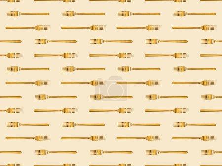 Foto de Vista superior de horquillas doradas aisladas sobre fondo beige, sin costuras - Imagen libre de derechos