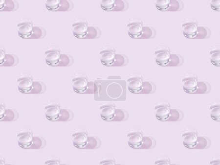Photo for Glasses of fresh water on violet, seamless background pattern - Royalty Free Image