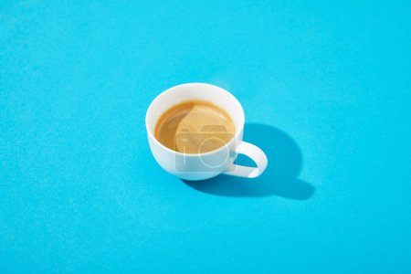 Photo for White cup of fresh coffee on blue background - Royalty Free Image