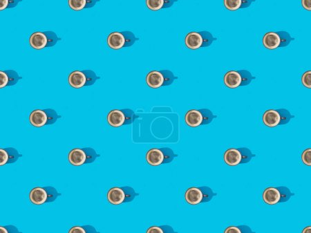 Photo for Top view of cups of fresh coffee on blue, seamless background pattern - Royalty Free Image