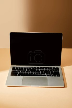Photo for Opened laptop with blank screen on beige background - Royalty Free Image