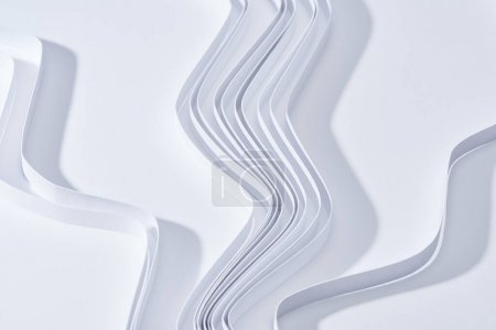 close up view of wavy paper stripes on white background