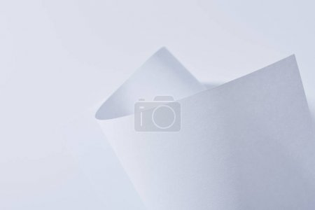Photo for Close up view of curved paper sheet isolated on white - Royalty Free Image