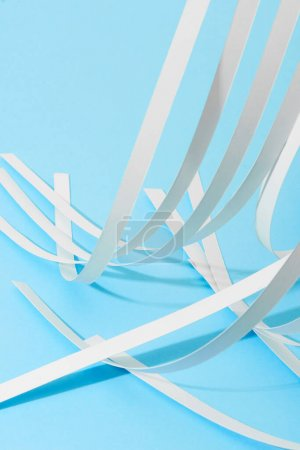 Photo for Close up view of white paper stripes on blue background - Royalty Free Image